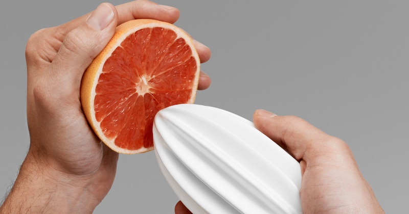 hand-squeezing grapefruit
