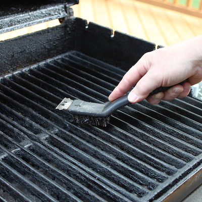 brushing barbecue grill