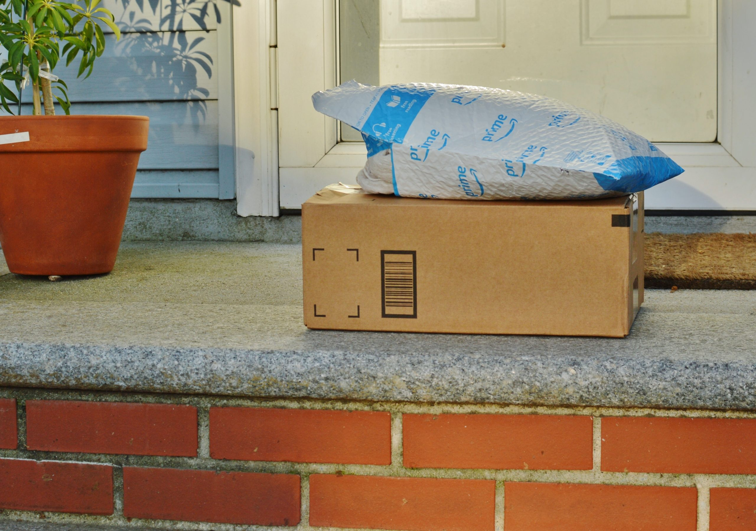 Amazon packages sitting on front step