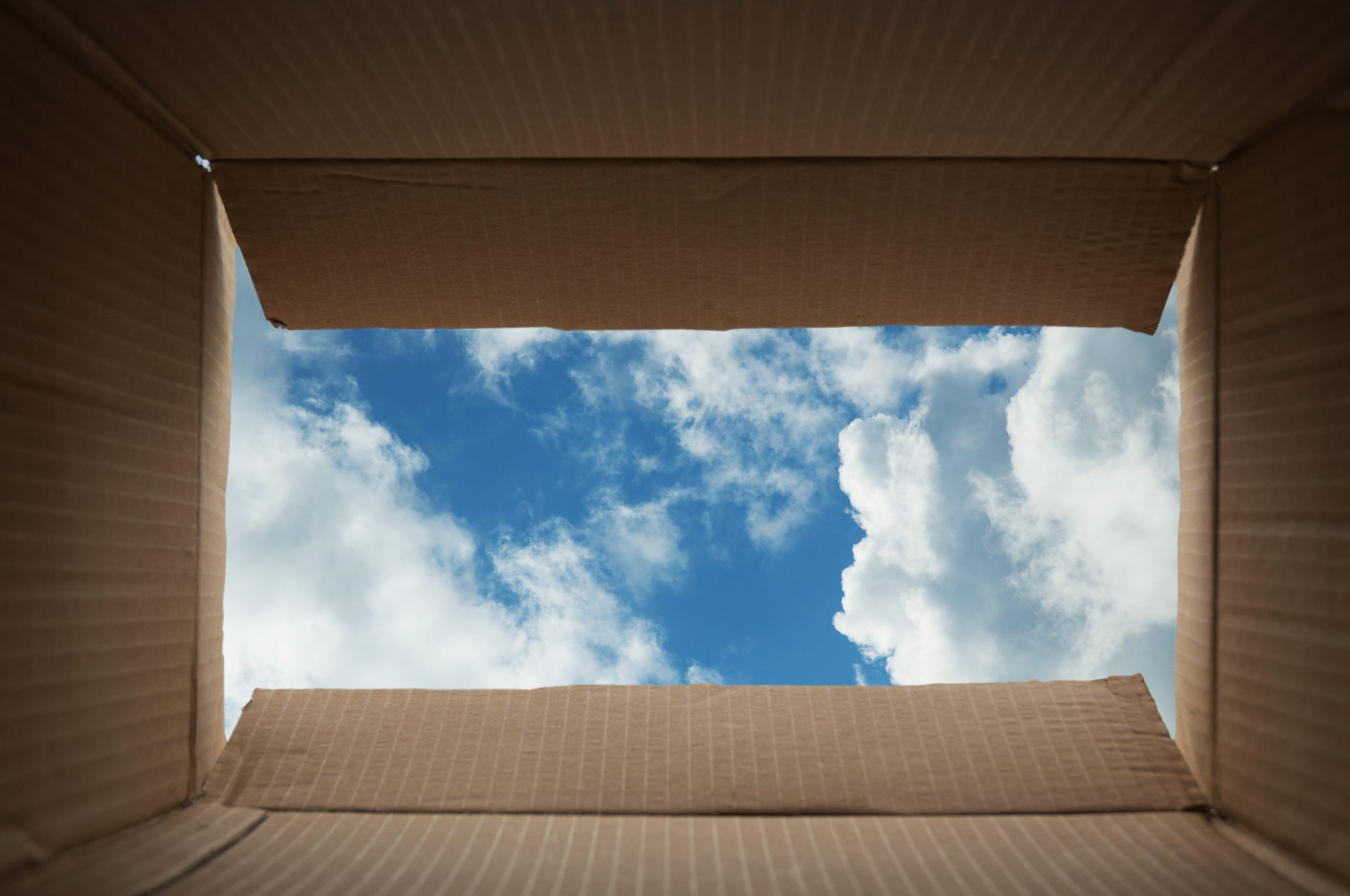 View from an open box looking at blue sky and clouds